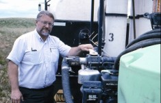 Simplot Grower Solutions Employee Mixing Chemicals