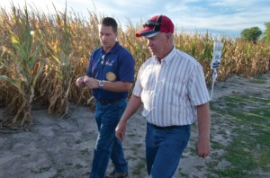Rick Greene of MFA (left) walks a test plot area with one of his grower customers.