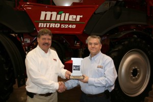 Todd Frish of Miller-St. Nazianz accepts the CropLife IRON Product Of The Year award from editor Eric Sfiligoj. The company's Nitro 5000 series sprayer was recognized with the award at the Wisconsin Crop Management Conference in Madison, WI, January 16, 2013.