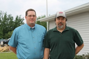DuPont Representative Scott Bishop, left, and Wilbur-Ellis Edmore Plant Manager Brian Collins.
