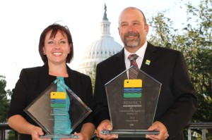 Laurel Deringer and Jim Fargo from Centennial Ag Supply with the company's Regional and National Environmental Respect Awards for 2013.