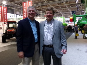 Chuck Gamble, manager of the Farm Science Review, visits with Jerry Roell, director of John Deere FarmSight, at Agritechnica 2013.
