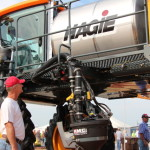 A Farm Progress attendee checks out the new 2014 Hagie STS Sprayer.