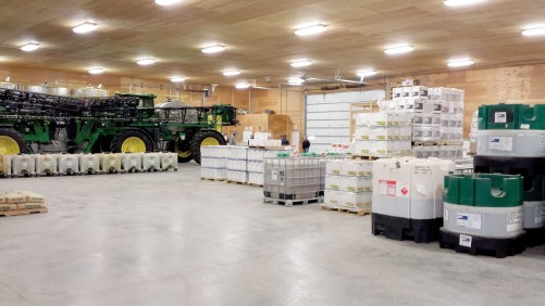 The warehouse floor is roomy enough to not only store products, but self-propelled sprayers that are not in use.