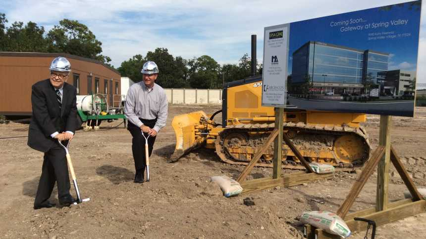 Jerry Stoller, president and founder of Stoller Group (left) participates in the recent groundbreaking ceremony for new Stoller offices.
