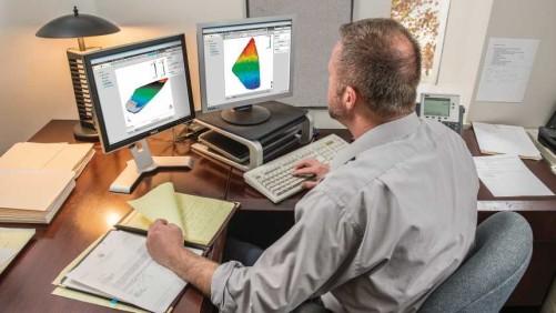 Ag retailer at computer