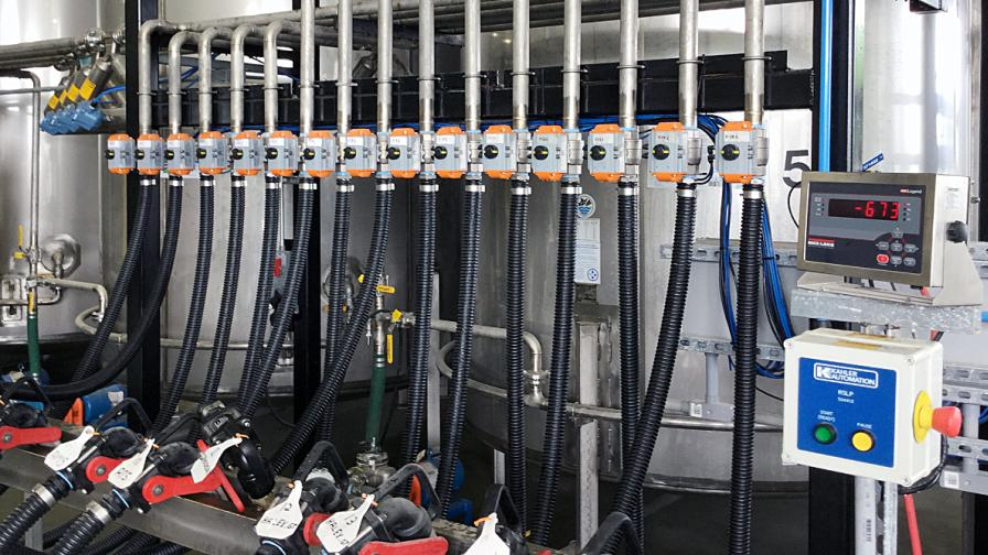 A liquid scale system by Kahler Automation for filling totes in the repack section of the facility.